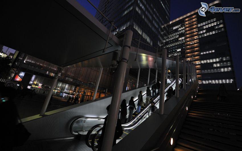 scala mobile, grattacieli, città notturno