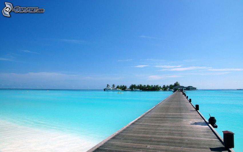 molo di legno, mare azzurro, isola