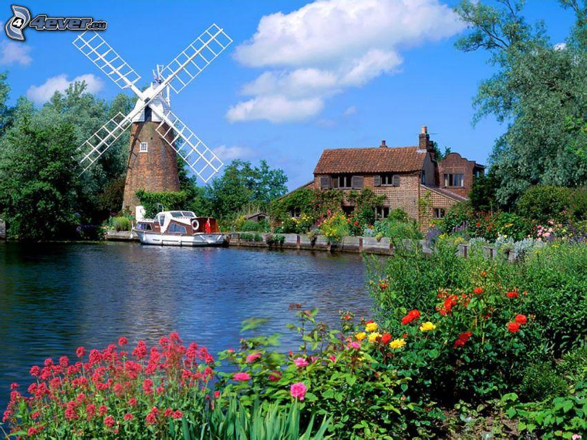 mulino a vento, fiori, acqua, casa di pietra, cielo