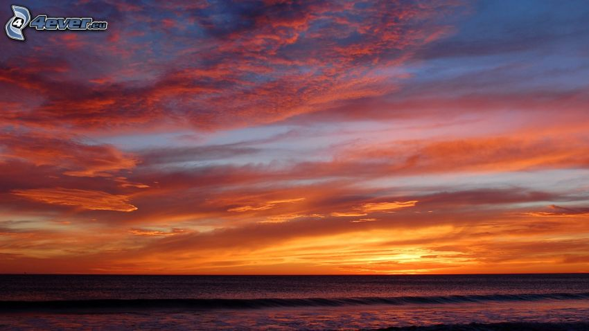 mare, cielo arancione, dopo il tramonto