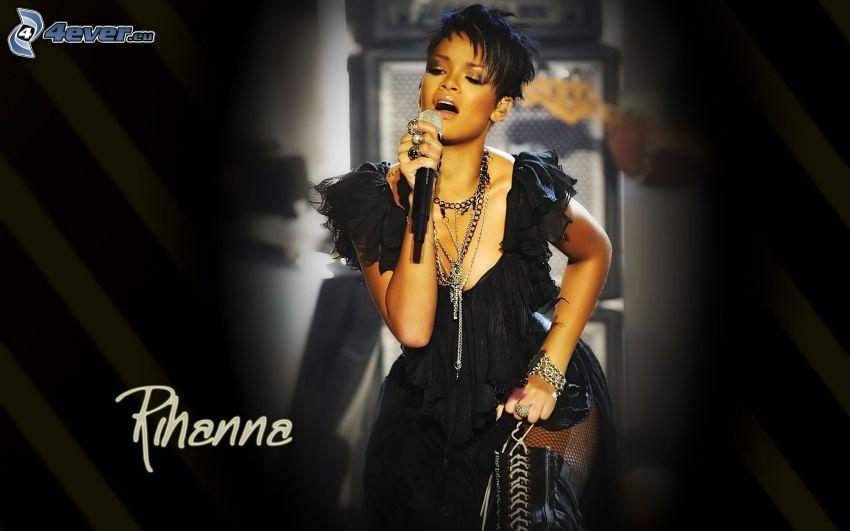 Rihanna, canto, abito nero