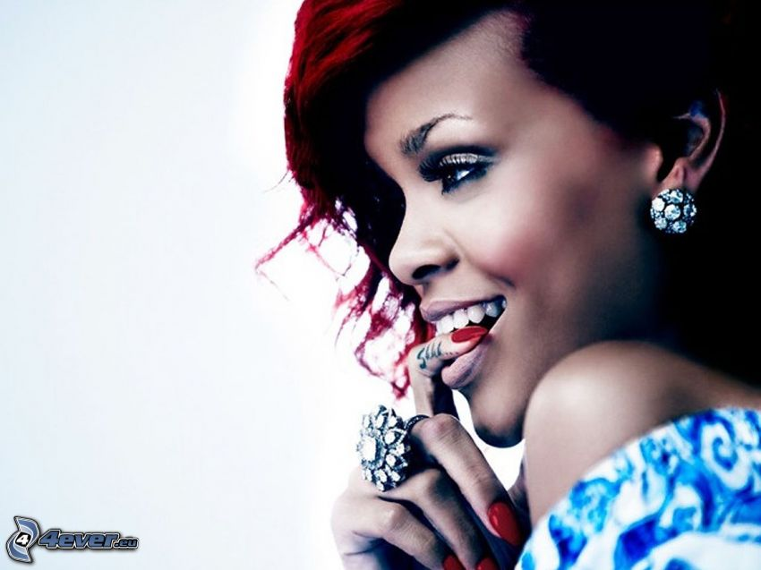 Rihanna, dito in bocca, sguardo seducente