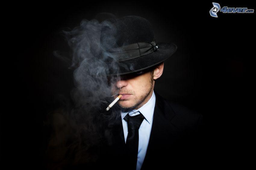 un uomo in un cappello, sigaretta, fumo