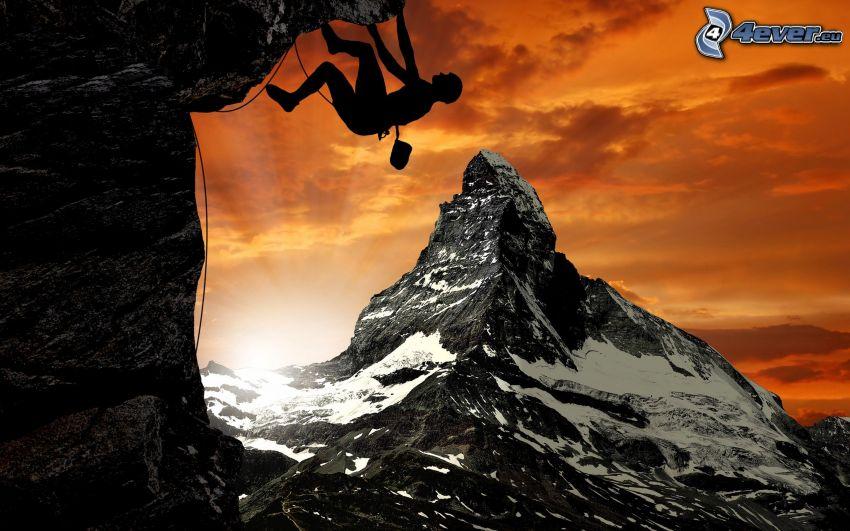 alpinista, montagne rocciose, cielo arancione, tramonto