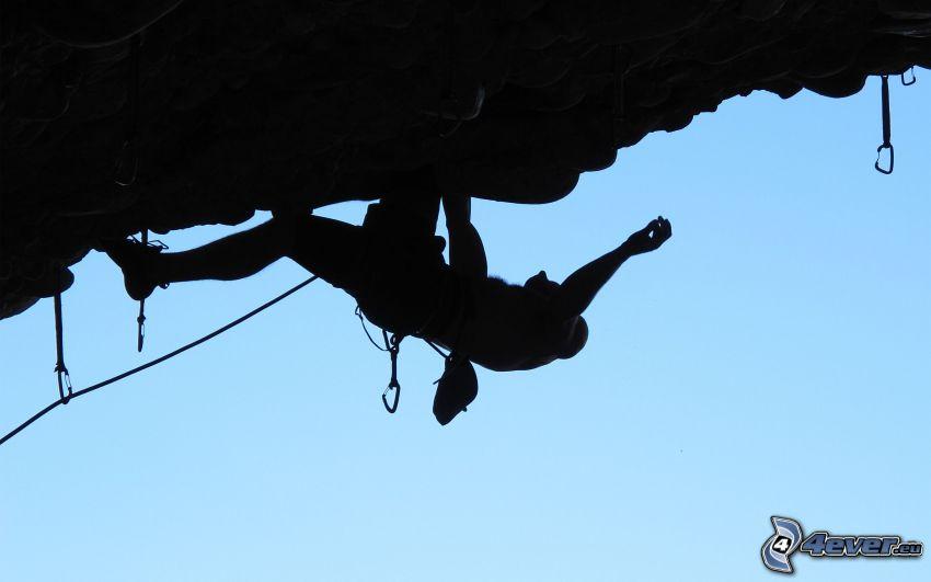 alpinista, siluetta di un uomo, carabina pre l´arrampicata
