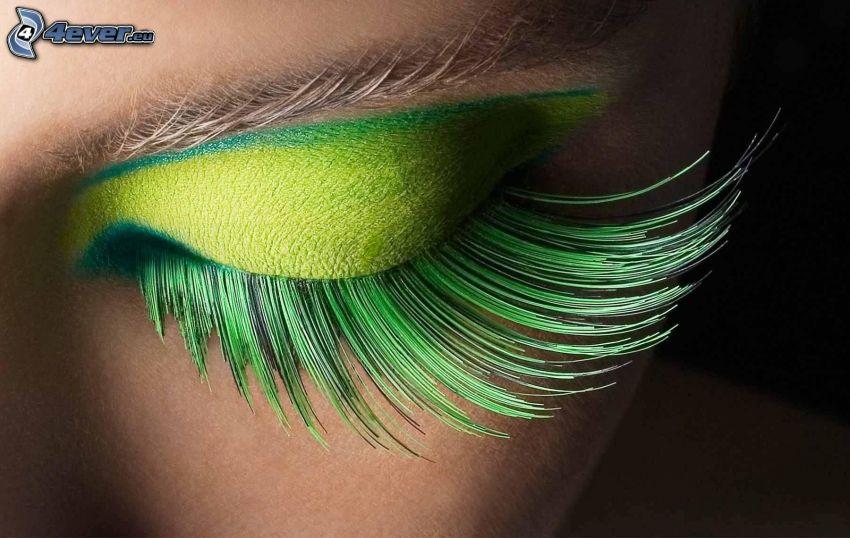 donna truccata, ciglia, verde