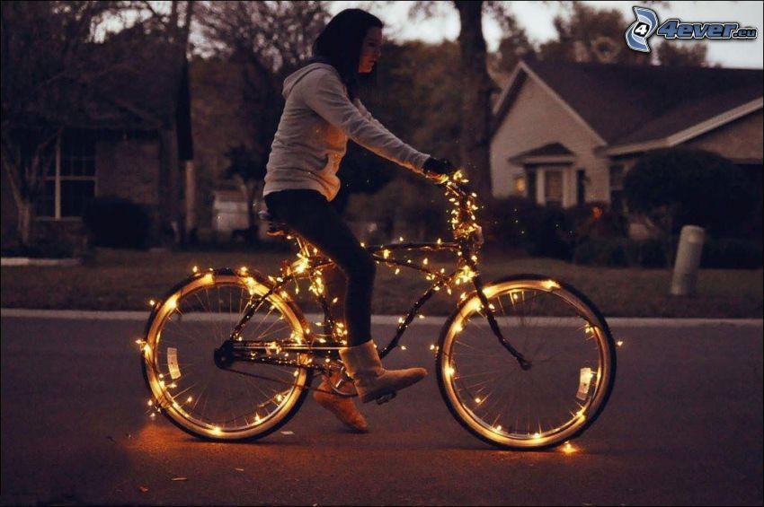 ragazza in bicicletta, illuminazione