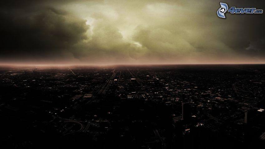 kilátás a városra, éjszaka, viharfelhők