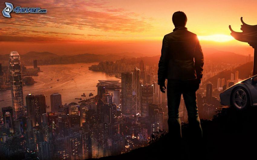 fiú sziluettje, kilátás a városra, Hong Kong, napnyugta, este
