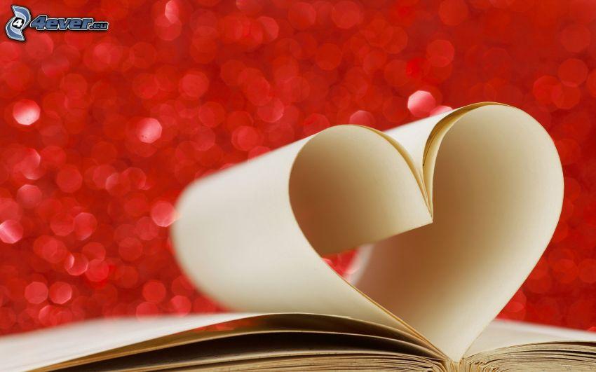 papír szív, könyv, piros háttér