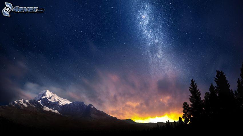 éjjeli égbolt, havas hegyek, fák sziluettjei