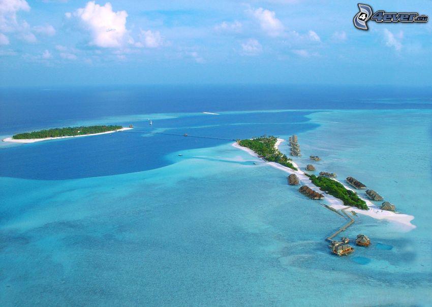 Hilton Resort, Maldív-szigetek, tengerparti nyaralók, faházikók, azúrkék tenger, szigetek