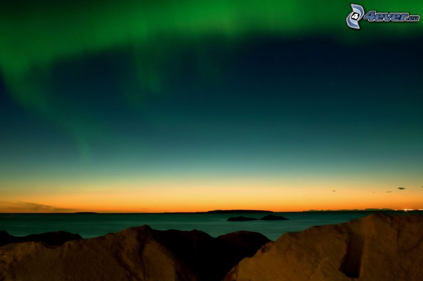 tenger, sarki fény, sziklák
