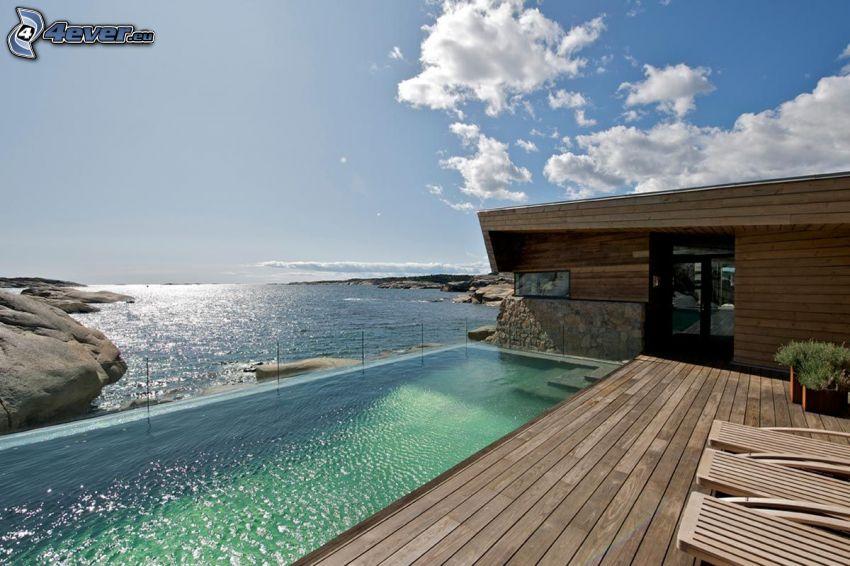 luksusowy dom, morze otwarte, skalisty brzeg