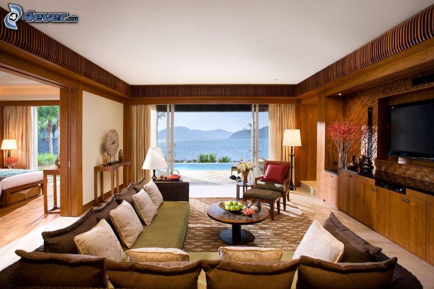 luksusowy salon, kanapa, widok na morze