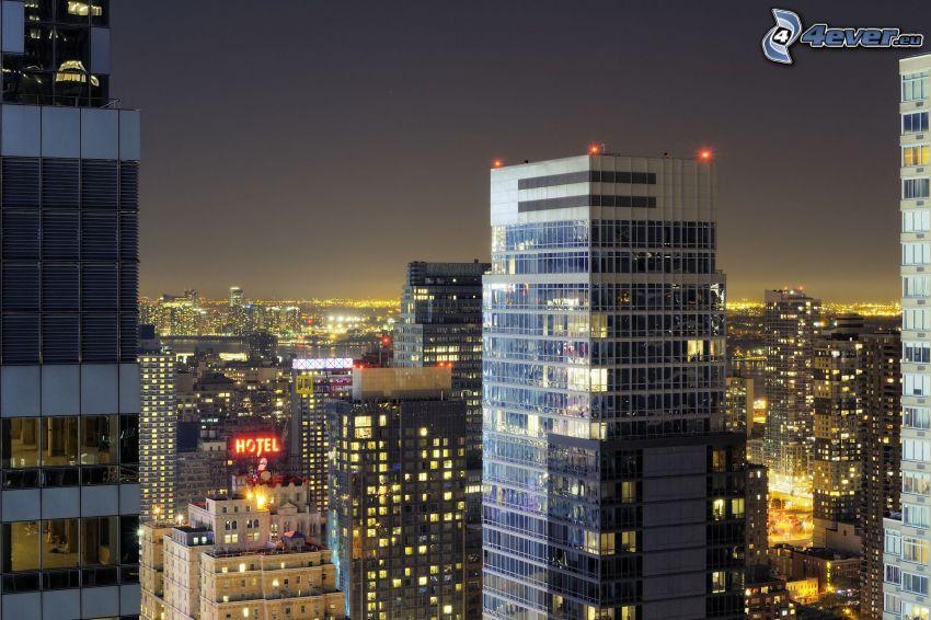 wieżowce, miasto nocą