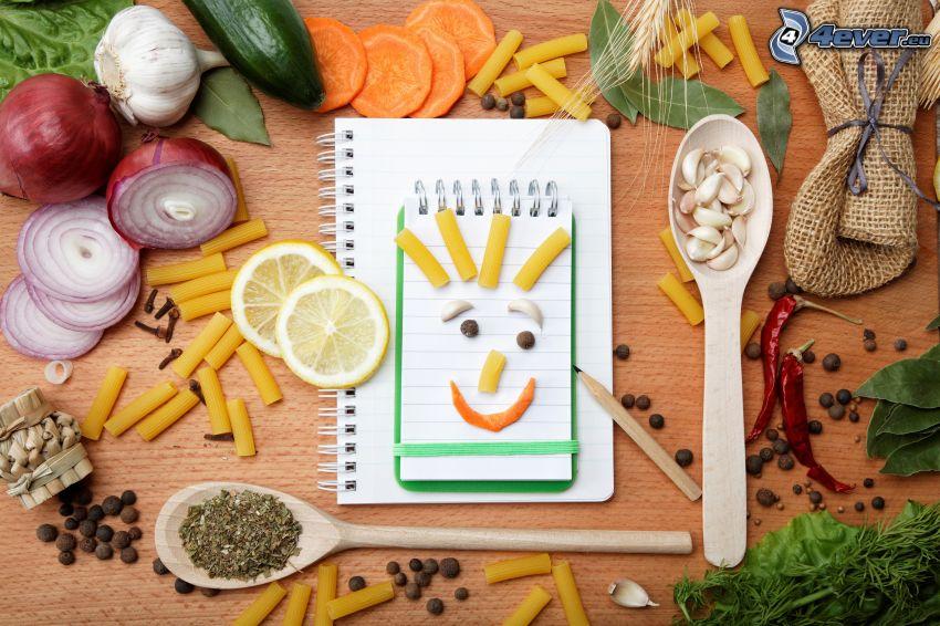 przyprawy, makaron, buźki, warzywa, plasterki cytryny