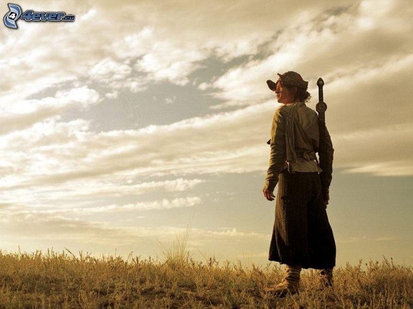 dziewczyna w polu, kobieta z mieczem, chmury