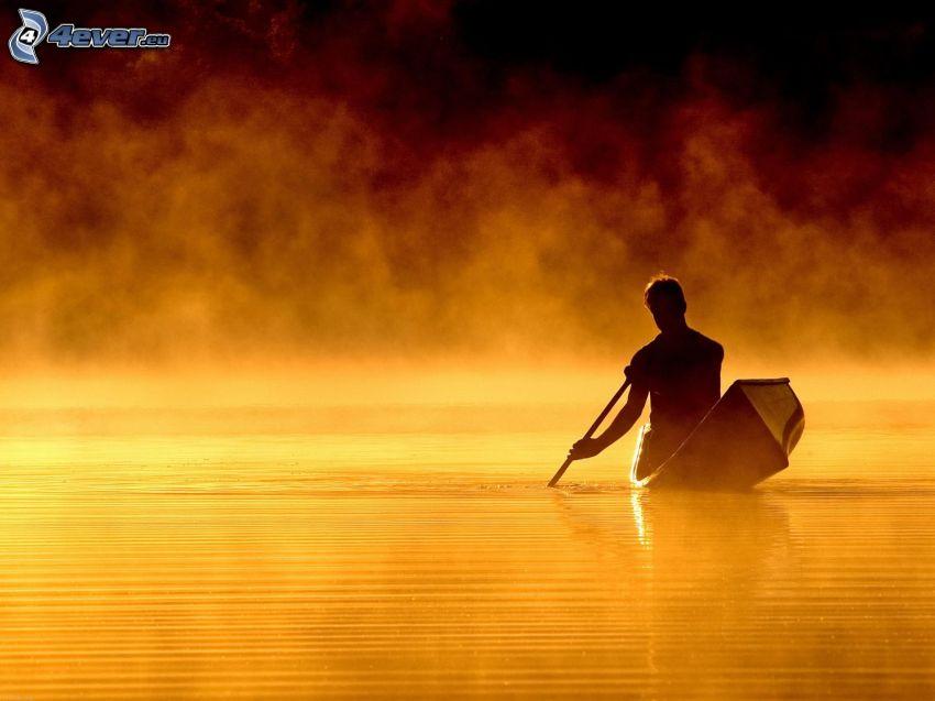 sylwetka mężczyzny, łódka, jezioro