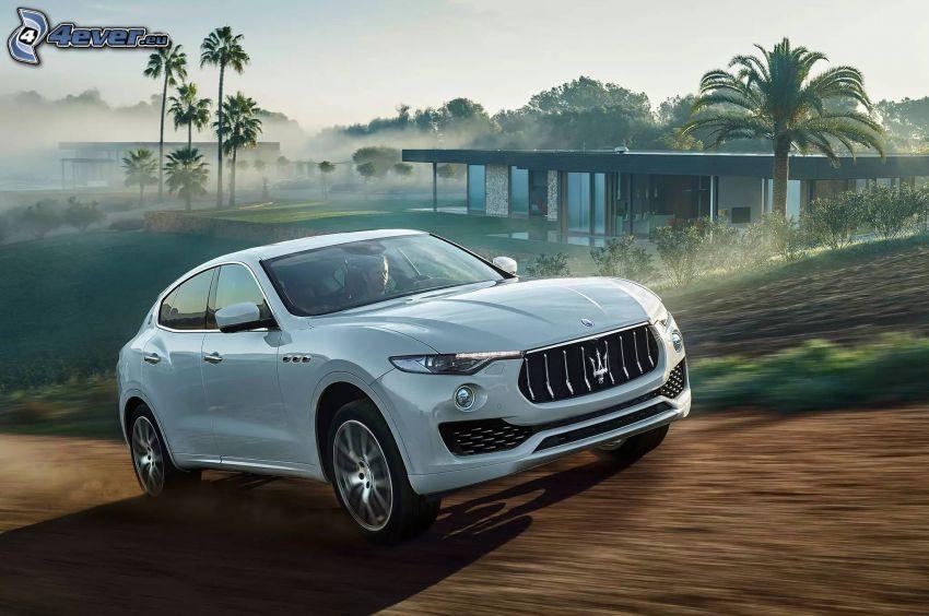 Maserati Levante, luksusowy dom, palmy