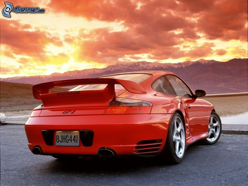 Porsche 911 GT2, pasmo górskie, pomarańczowe chmury