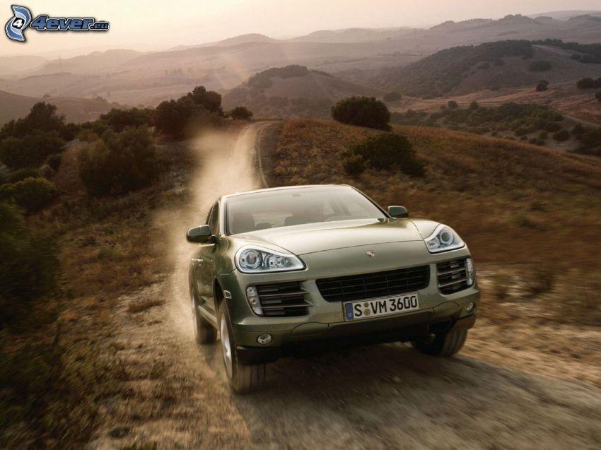 Porsche Cayenne, SUV, wzgórza, polna droga, pył
