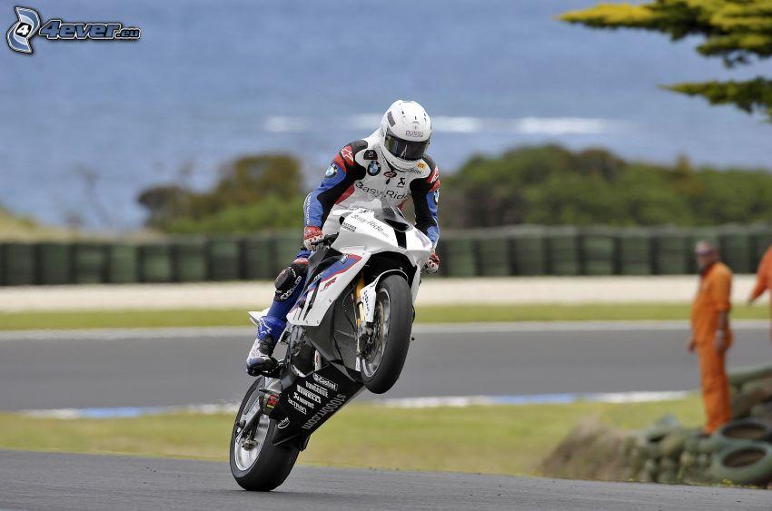 Motocykl BMW, motocyklista, akrobacje, wyścigi, torowe, mechanik