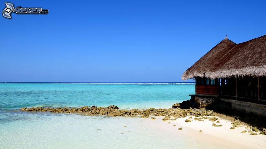 dom przy morzu, płytkie lazurowe morze