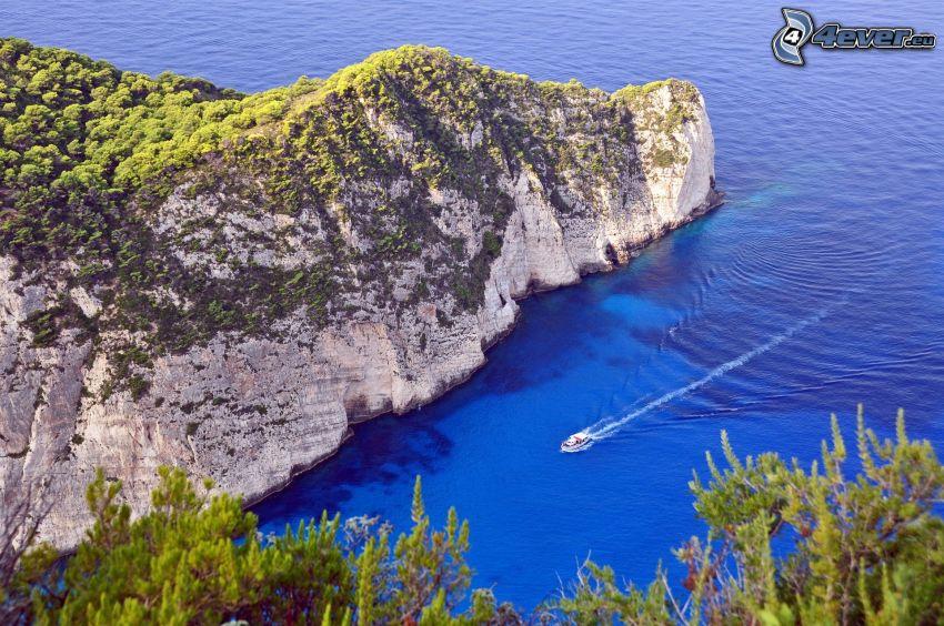 skała w morzu, statek, zatoczka