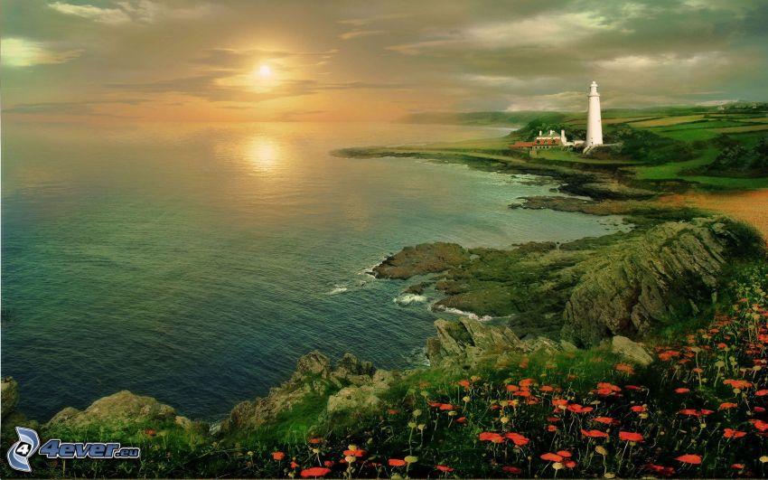 Zachód słońca nad morzem, latarnia morska, skalisty brzeg