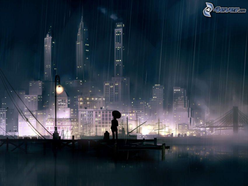 miasto nocą, sylwetka mężczyzny