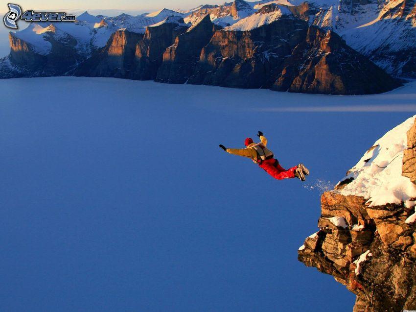 BASE Jump, skok, adrenalina, skały, zaśnieżone góry