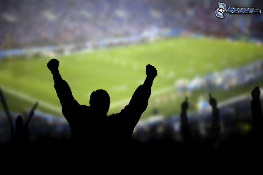 sylwetka mężczyzny, boisko do piłki nożnej, radość