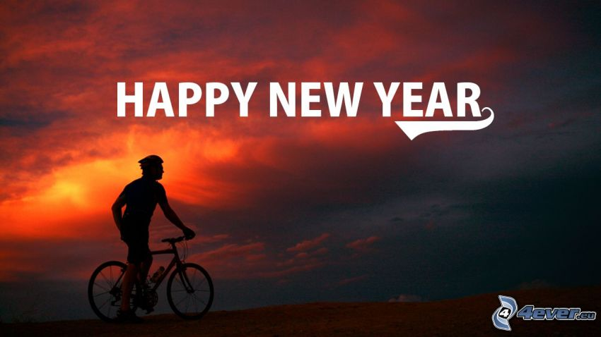 Szczęśliwego Nowego Roku, happy new year, rowerzysta, czerwone niebo