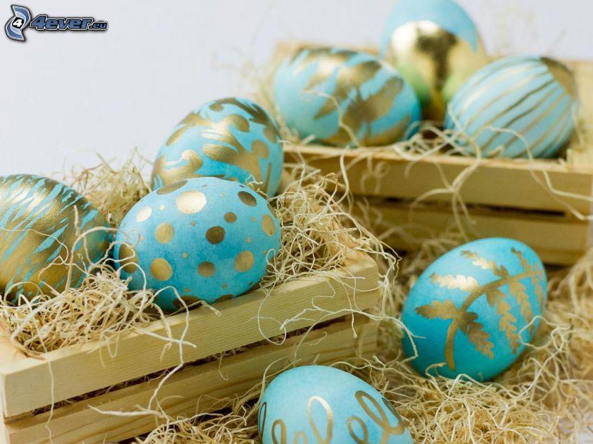 wielkanocne jajka, słoma, skrzynki