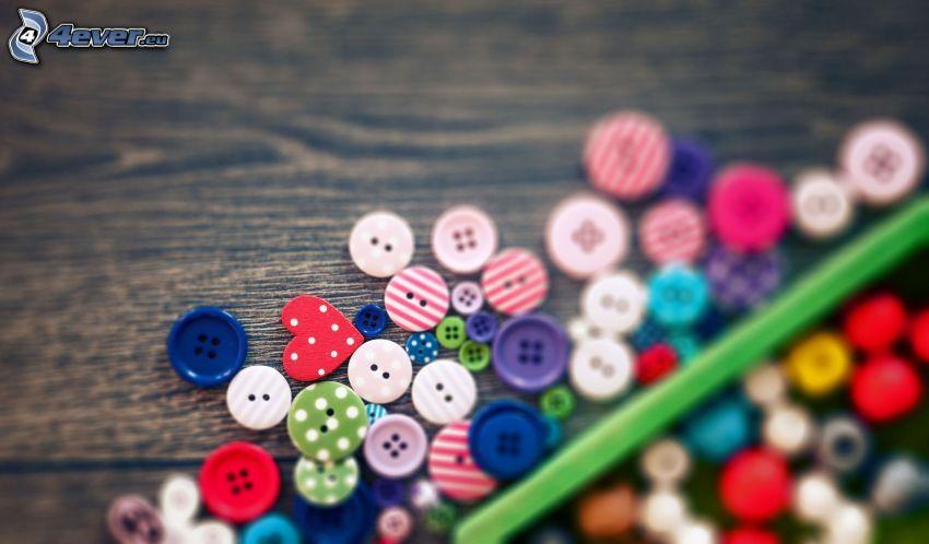 gombíky, ceruzka