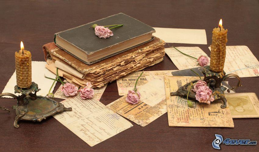 staré knihy, sviečky, ružové ruže, pošta, pohľadnica