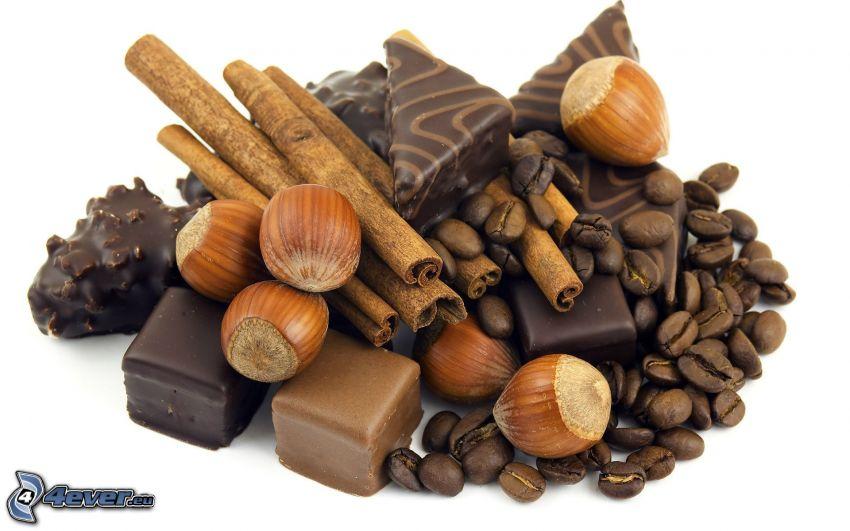 čokoládové pralinky, lieskové orechy, škorica, kávové zrná