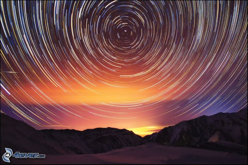 rotácia Zeme, hviezdy, zasnežené hory