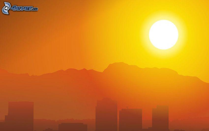 západ slnka nad horami, siluety mrakodrapov, žltá obloha