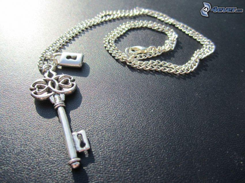 strieborný prívesok, kľúč, retiazka