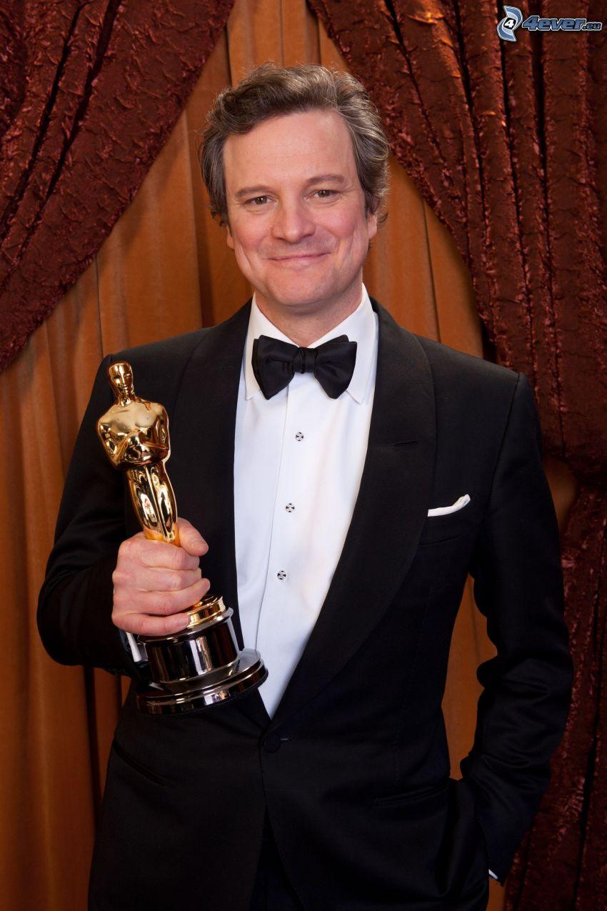 Colin Firth, muž v obleku, oskar, úsmev, motýlik