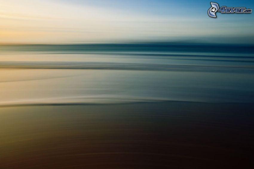 pláž po západe slnka