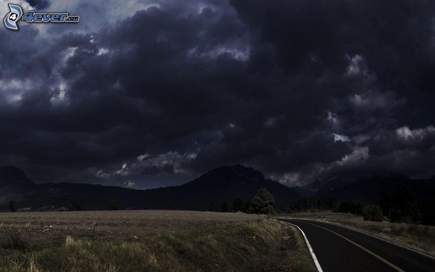 búrkové mraky, kopce, cesta