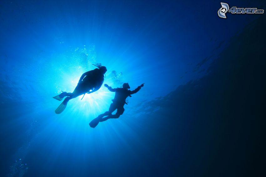 potápači, slnečné lúče