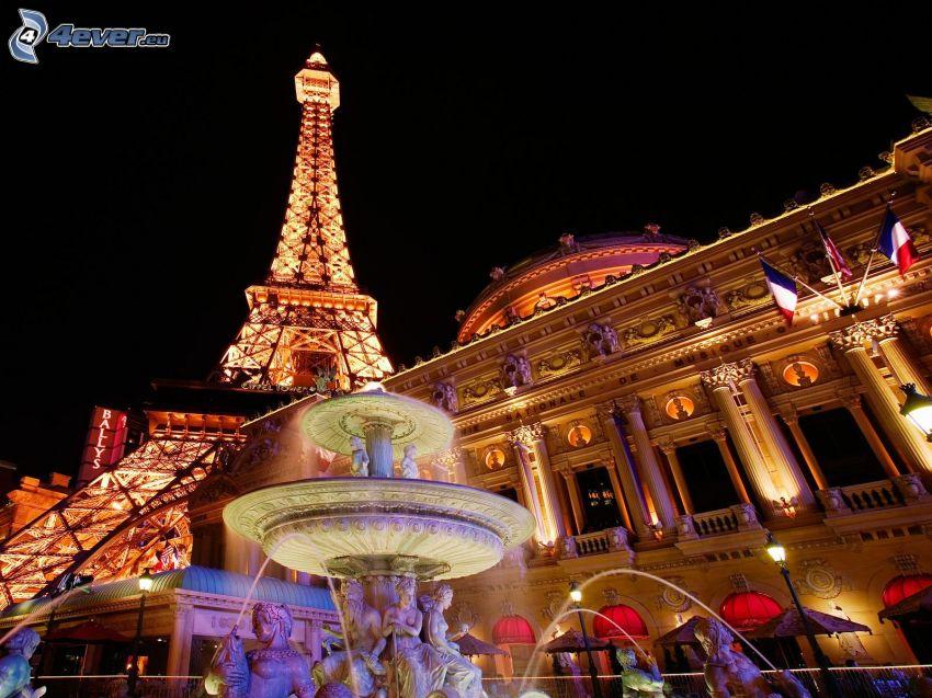 Paríž, Francúzsko, rozsvietená Eiffelova veža, fontána, noc