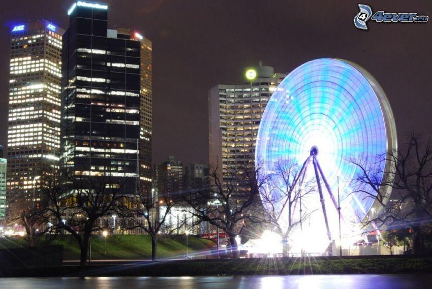 koleso, osvetlenie, budovy, večer