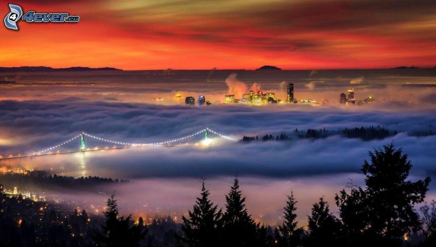 osvetlený most, oblaky, oranžový západ slnka