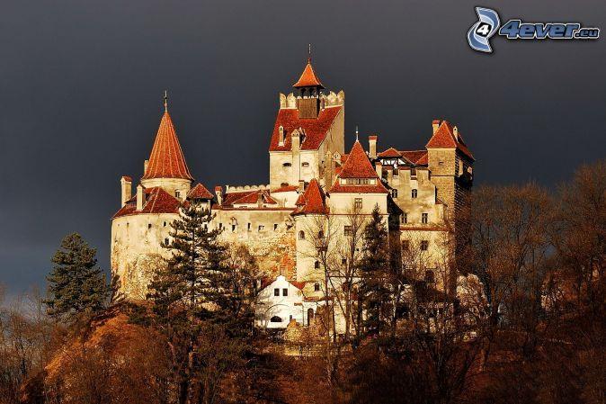Hunyad, castle, autumn trees, dark sky