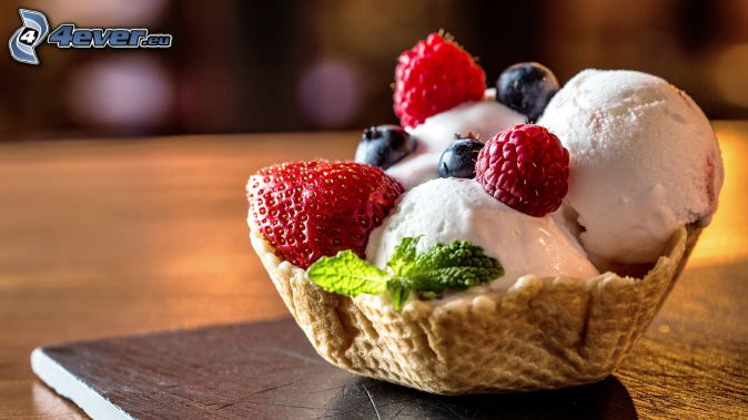 ice cream with fruit, cone, raspberries, blueberries, mint